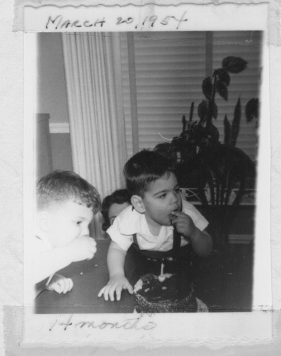 "March 20, 1953 - ""First piece of cake. Grabbed a handful of cake and pushed in his mouth. Loved the chocolate, Barry [cousin] helped him"""