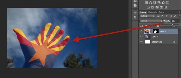 Letting the hand show through by dropping the opacity of the flag layer to 63%