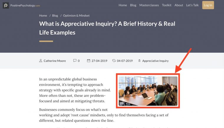 """Screen shot of article """"What is Appreciative Inquiry? a Brief History and Real Life Examples""""  A red box and arrow indicates a photo of a group of happy diverse people sitting in a conference room."""