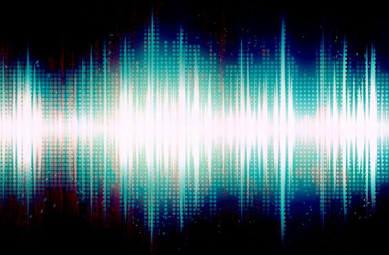 Brightly colored audio sound wave on black background